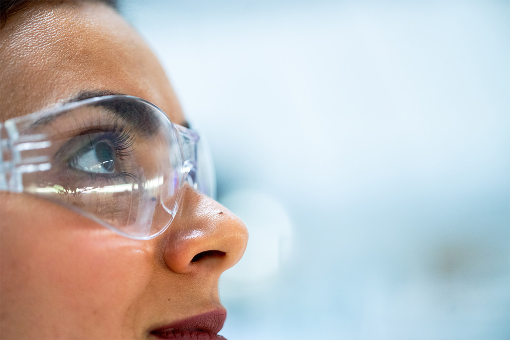 Female factory wearing eye protection to prevent eye injuries in the workplace