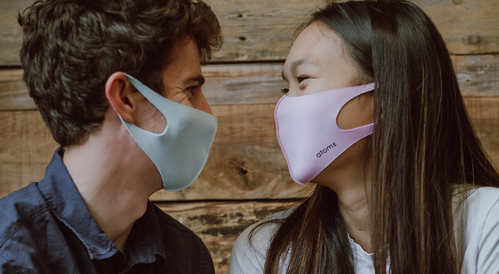 nJoy Vision glasses fog blog image of two young people wearing masks looking fondly at each other