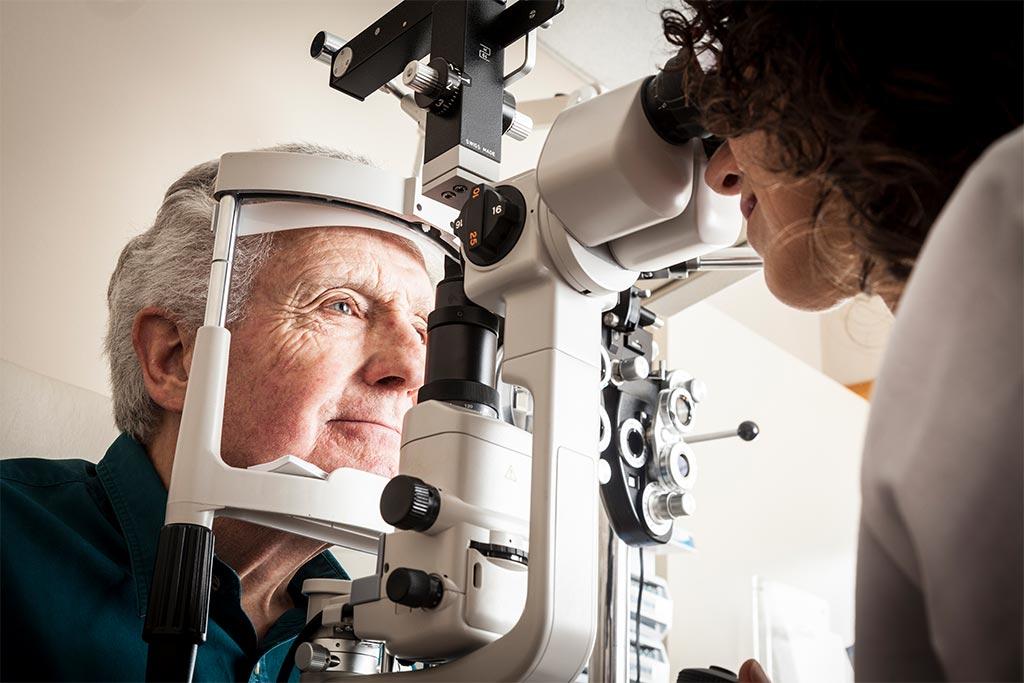 nJoy Vision June is Cataract Awareness Month blog post feature image of an elderly cataract patient receiving an eye exam