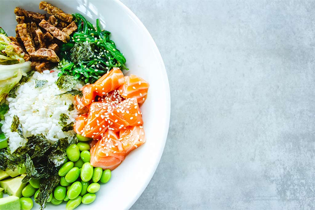 nJoy Vision 10 Healthy Foods for Health Eye blog feature image of a bowl of salmon and other nutritious foods